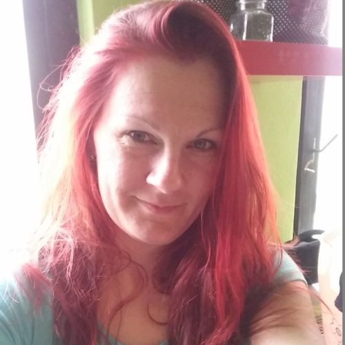Paní Patricie sčervenými vlasy, selfie